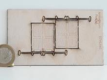 2 portes en bois fermées sur glissière